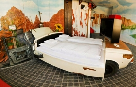 1370938782_classic-cadillac-car-inside-the-room-for-bed_858e4002.jpg